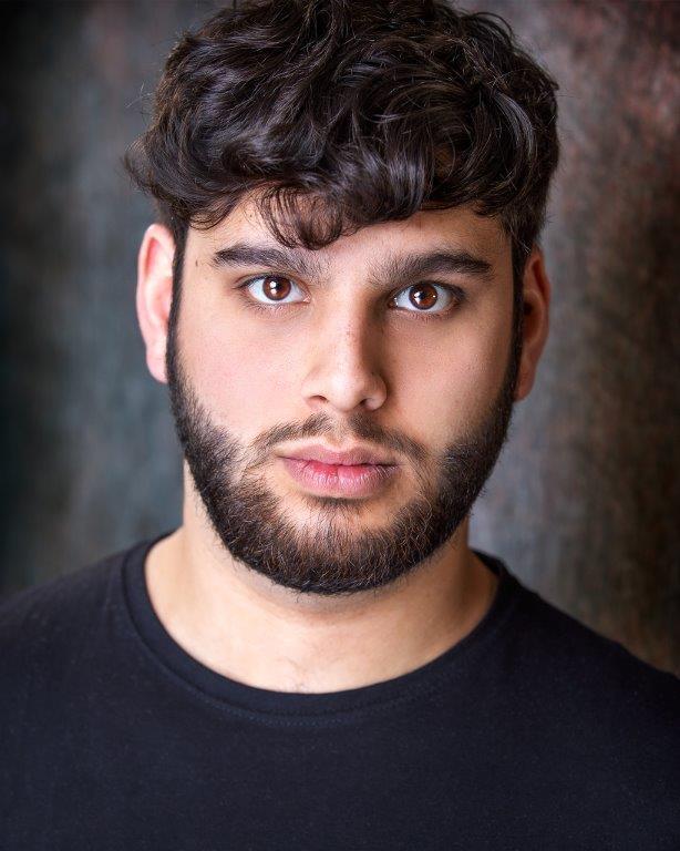headshot of Ajay