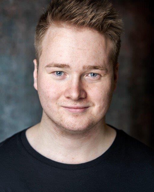 headshot of Josh